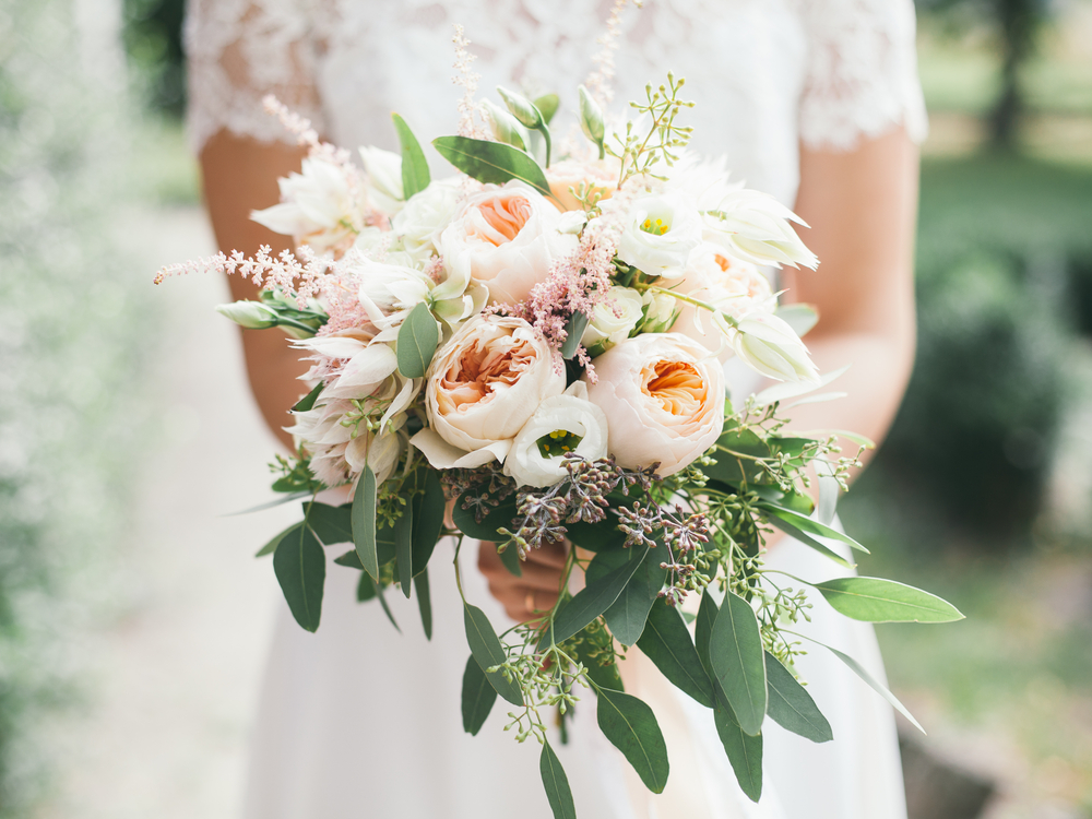 The History Of The Bridal Bouquet Rose Blossom